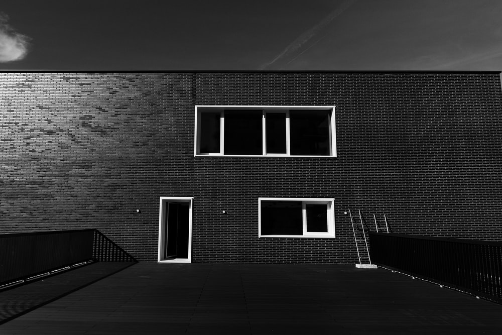 grayscale photo of 2 storey building