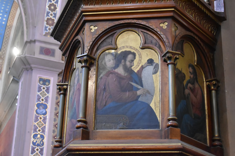brown wooden framed jesus christ painting