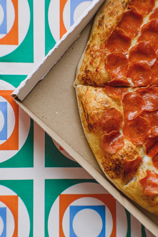 pizza on brown cardboard box