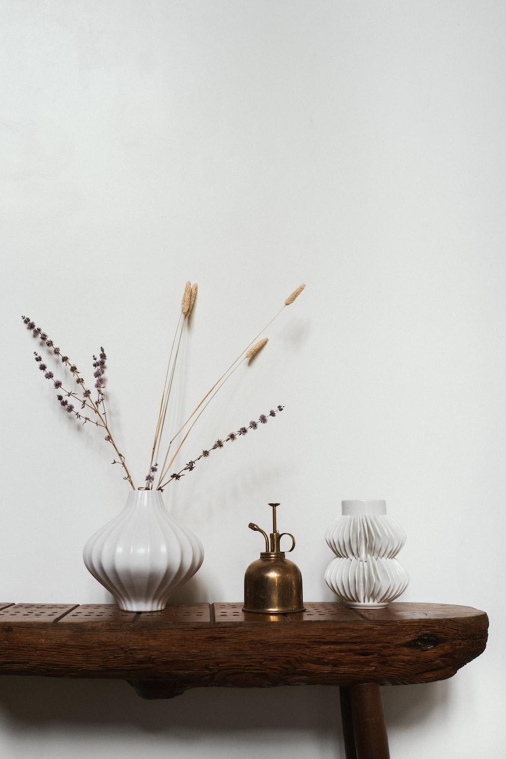 white ceramic vase with brown wooden sticks