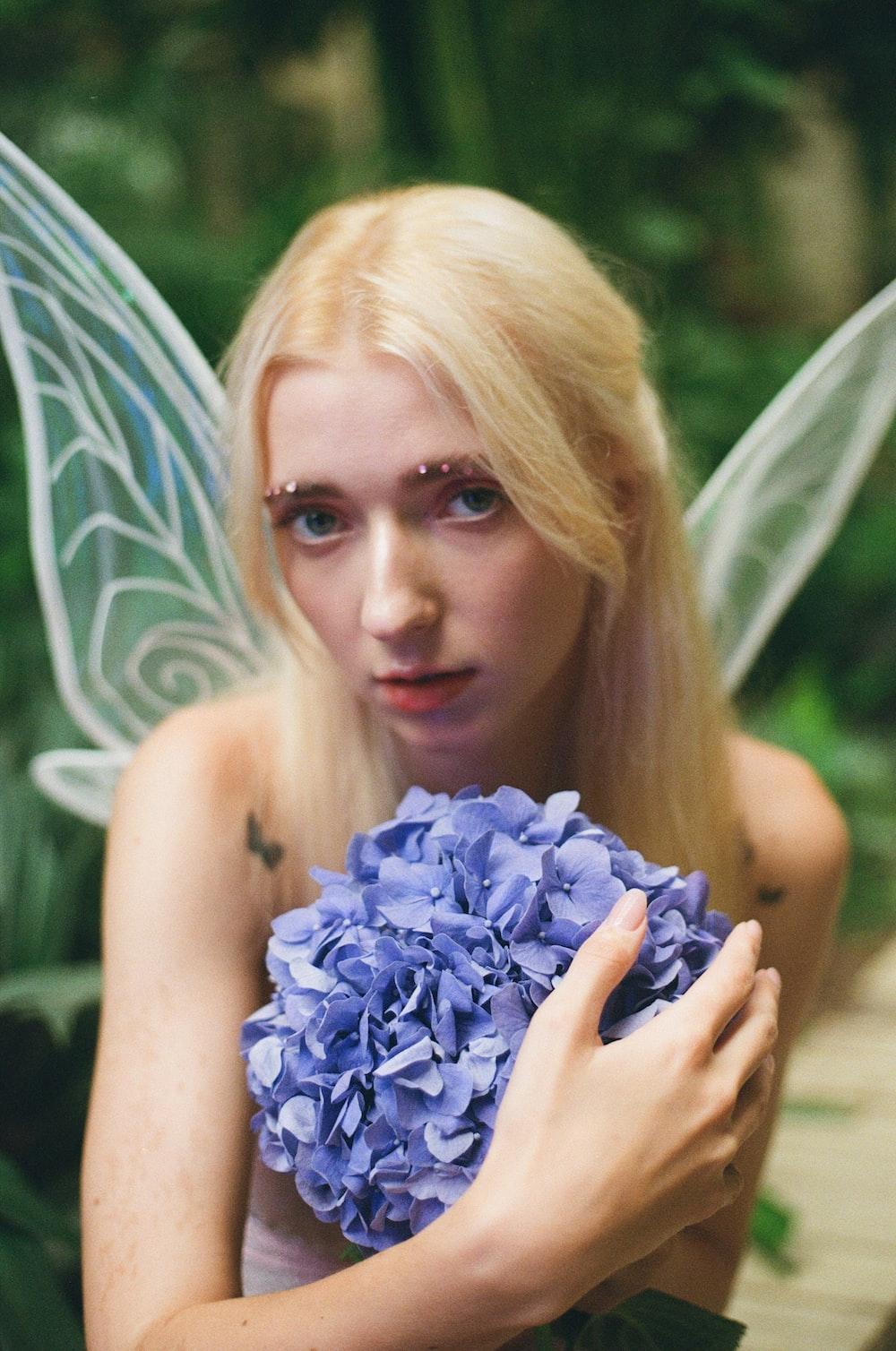 woman holding blue flower bouquet