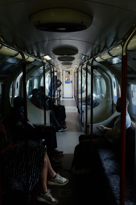 people sitting on train seat