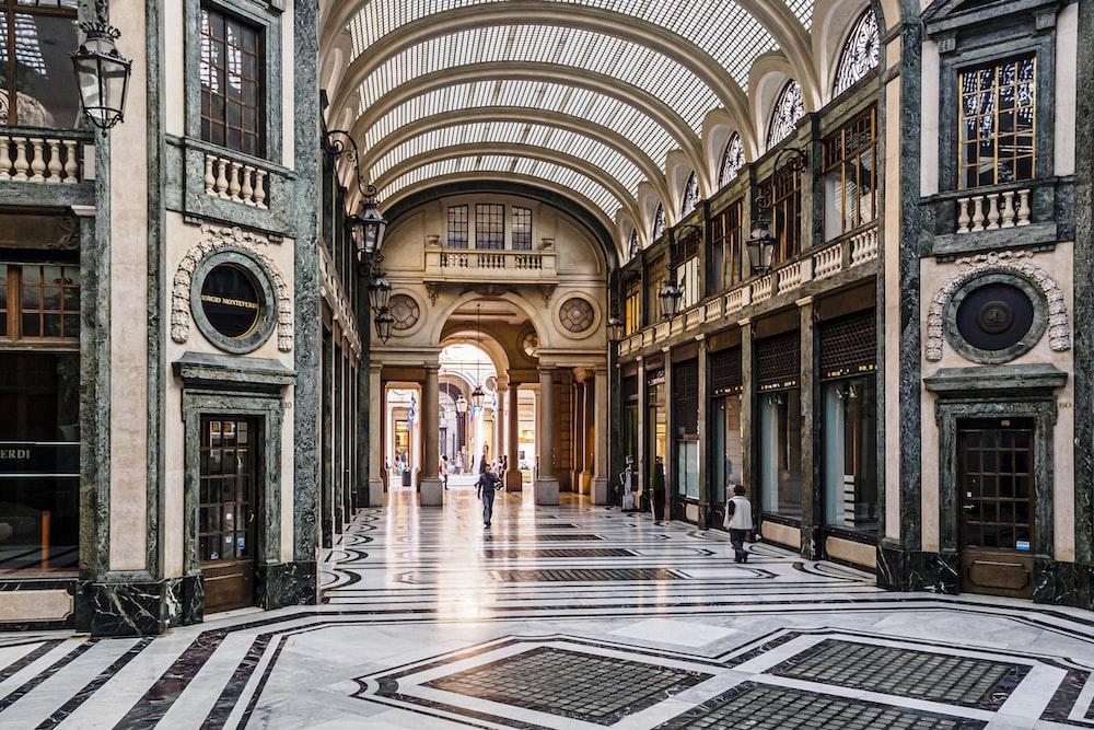 people walking on hallway of building