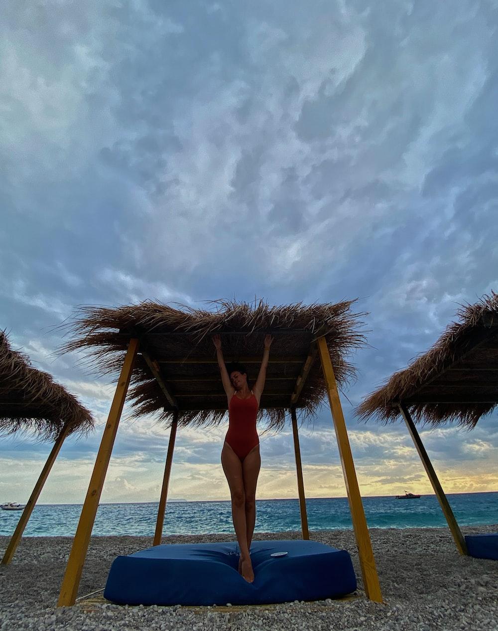 woman in red bikini standing on beach