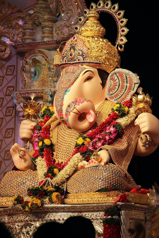 white and gold hindu deity figurine