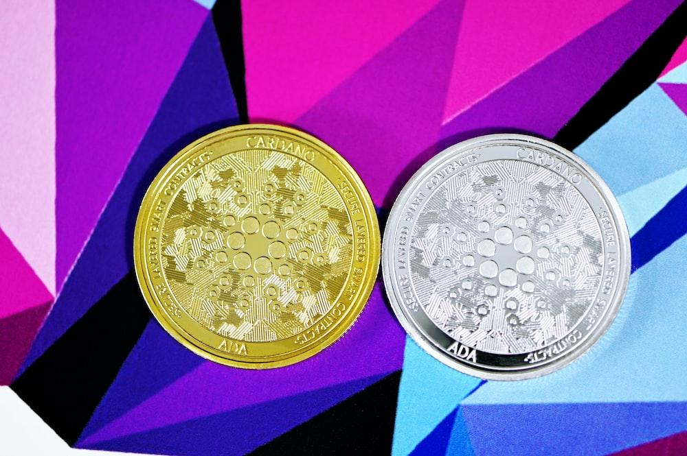 gold round coin on purple box
