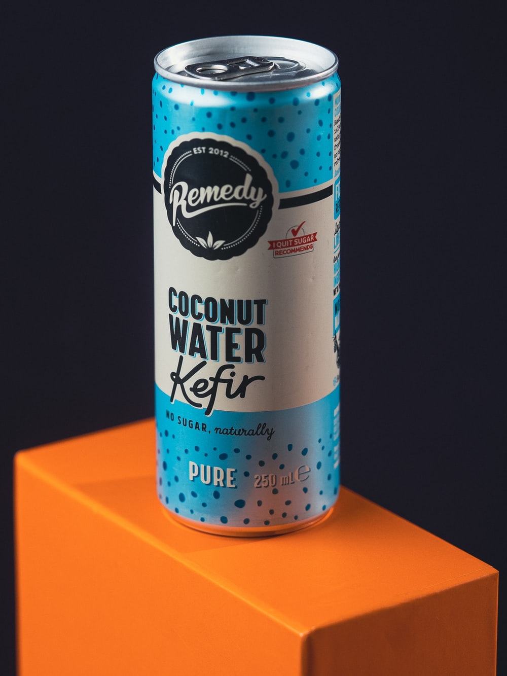red and white can on orange surface