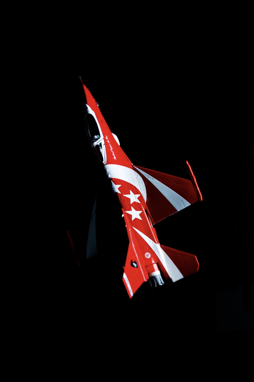 red and white plane toy