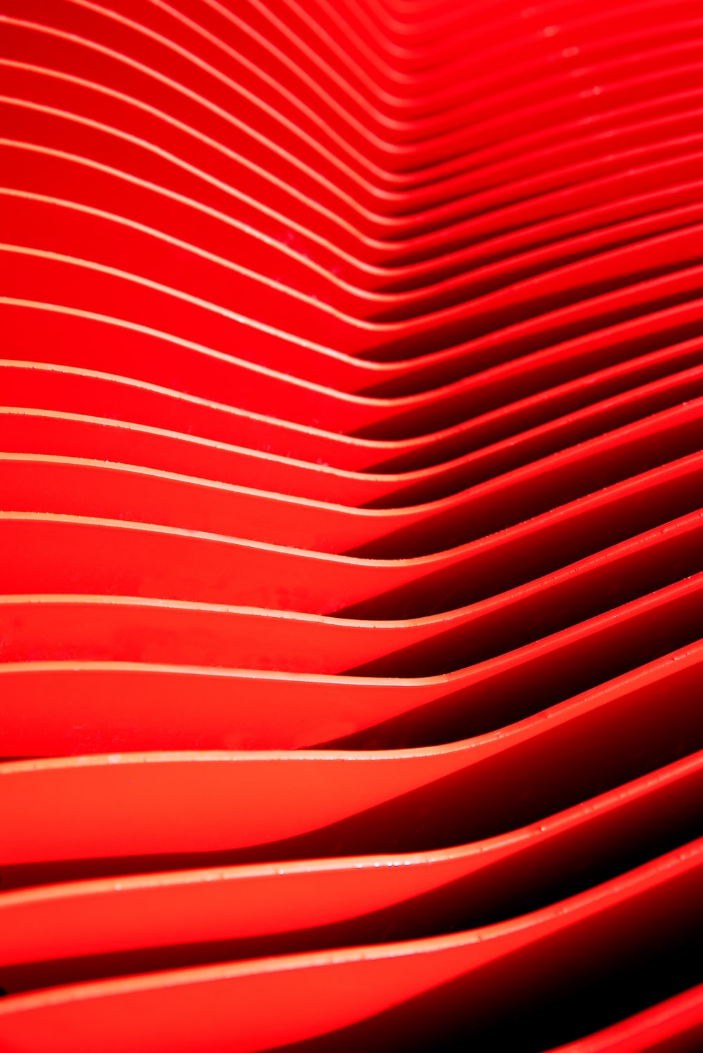 red plastic container on white surface