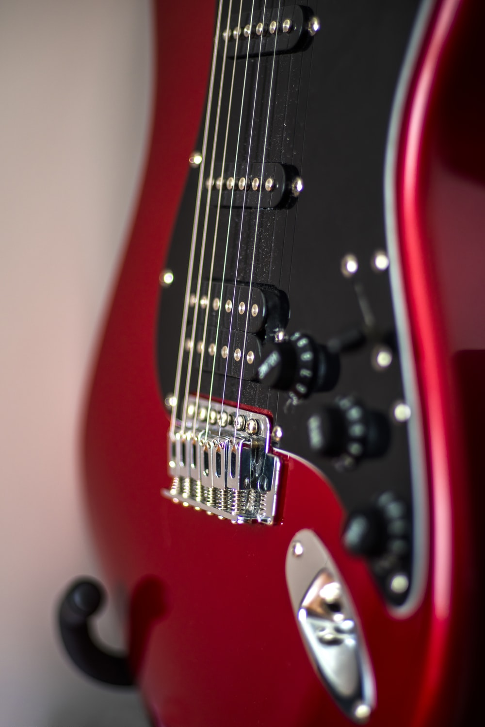 red and black electric guitar