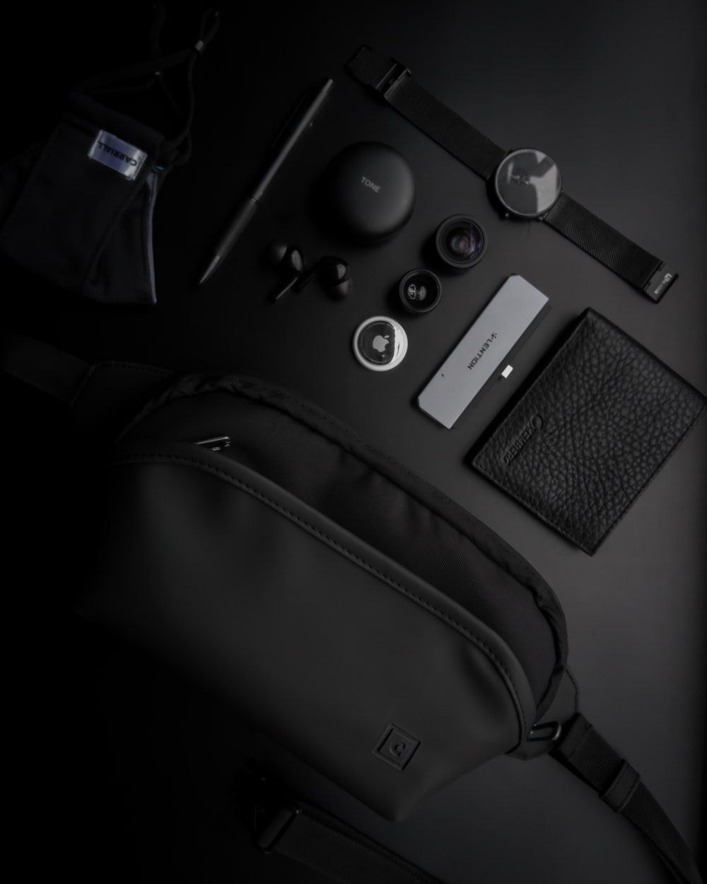 black and silver camera on black leather bag