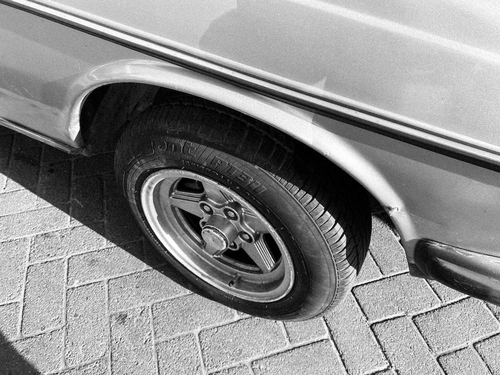 gray car with black wheel