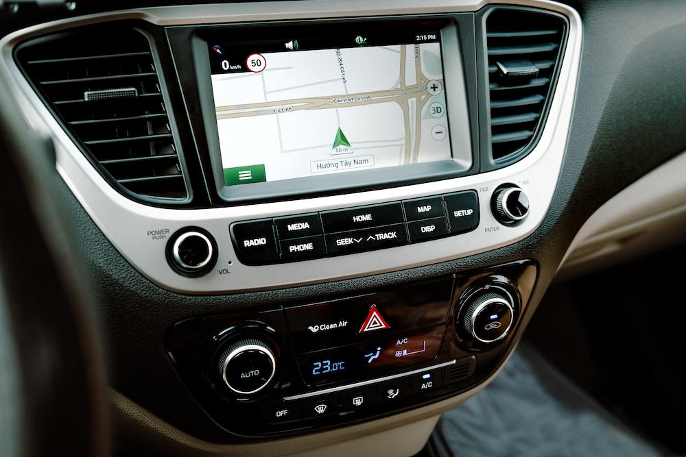 black car stereo turned on during daytime