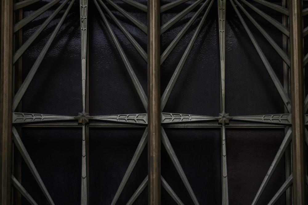 brown wooden sticks on black metal frame
