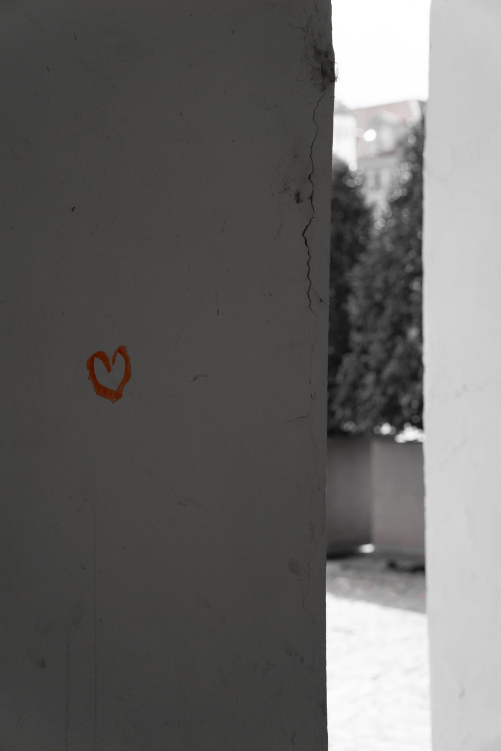 red heart on gray concrete wall