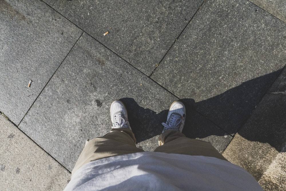 person in gray pants and black shoes