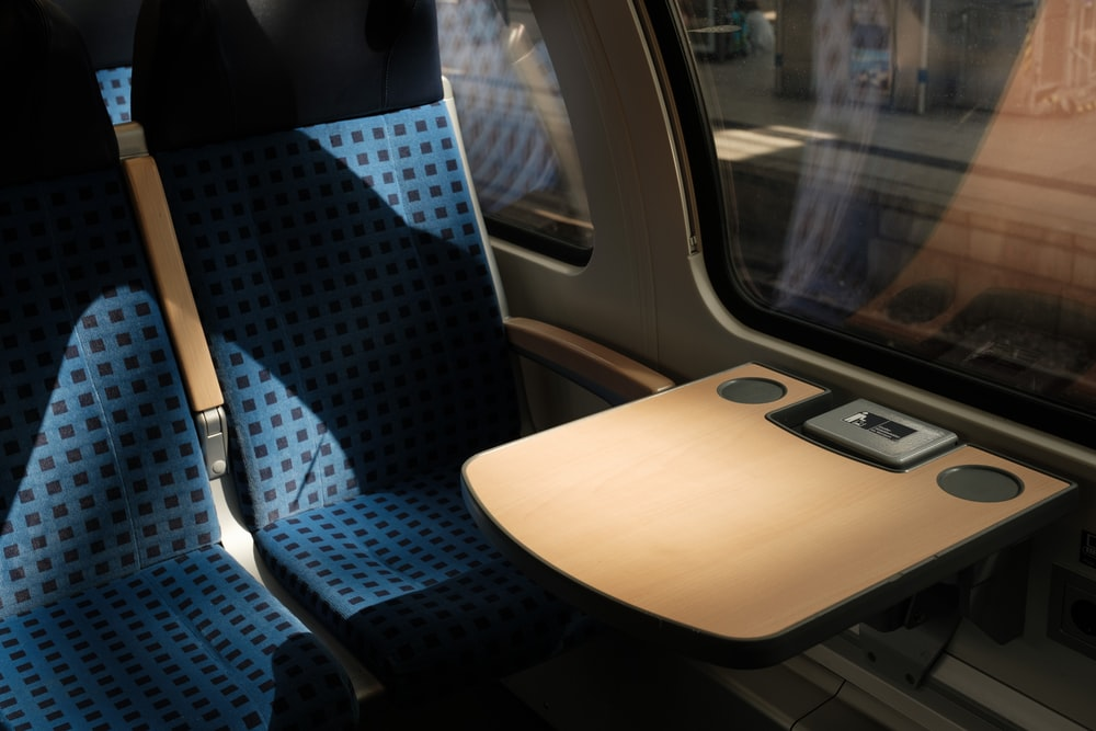 blue and white bus seat