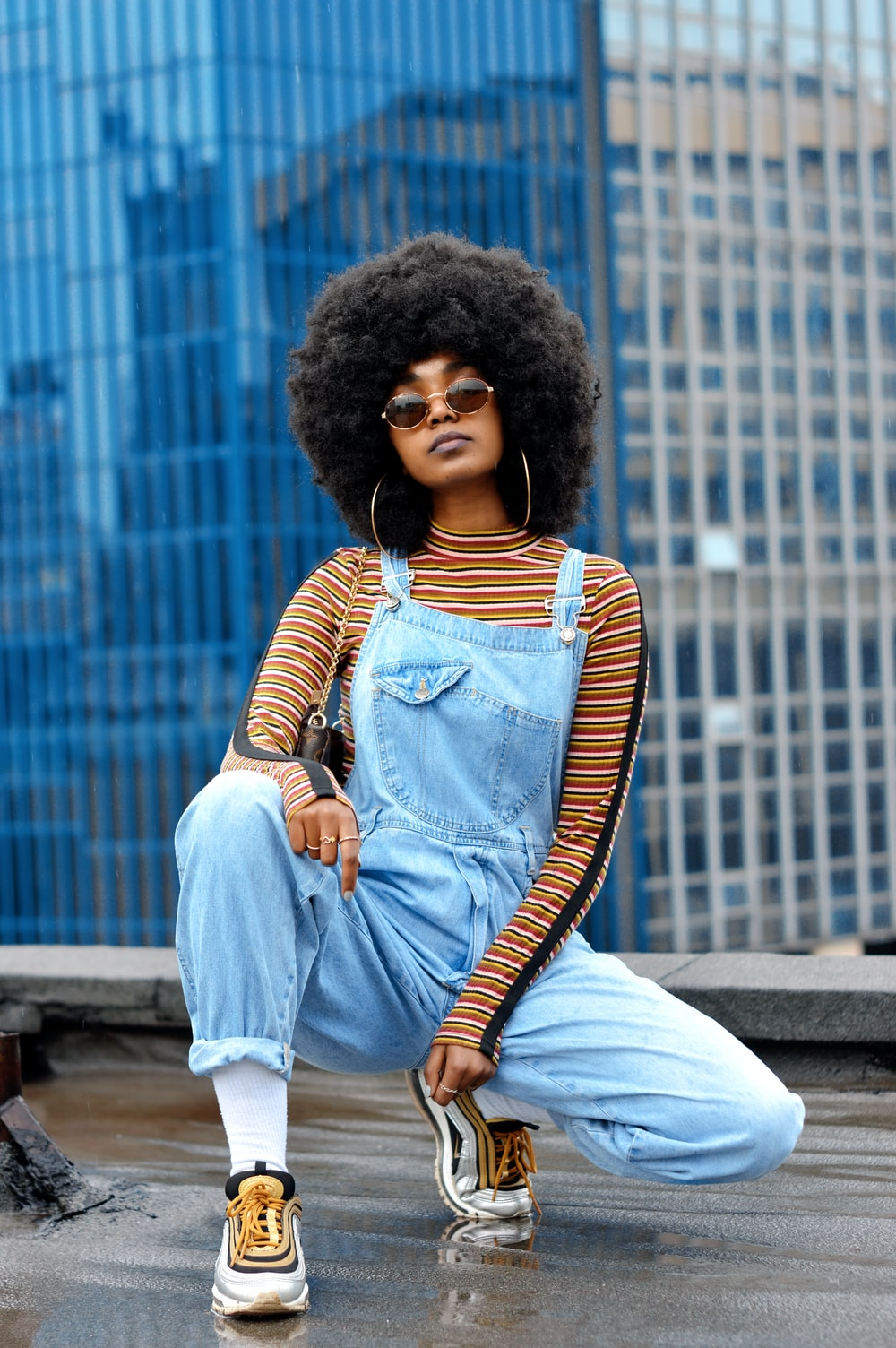woman in blue denim jacket sitting on concrete bench
