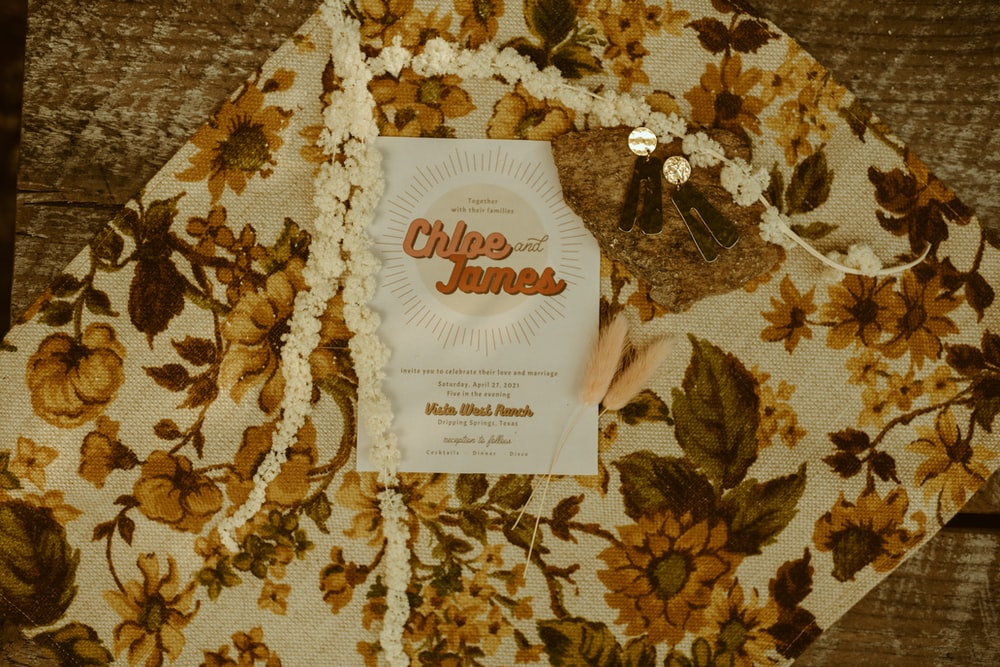 UNKs tea bags on brown and white floral textile
