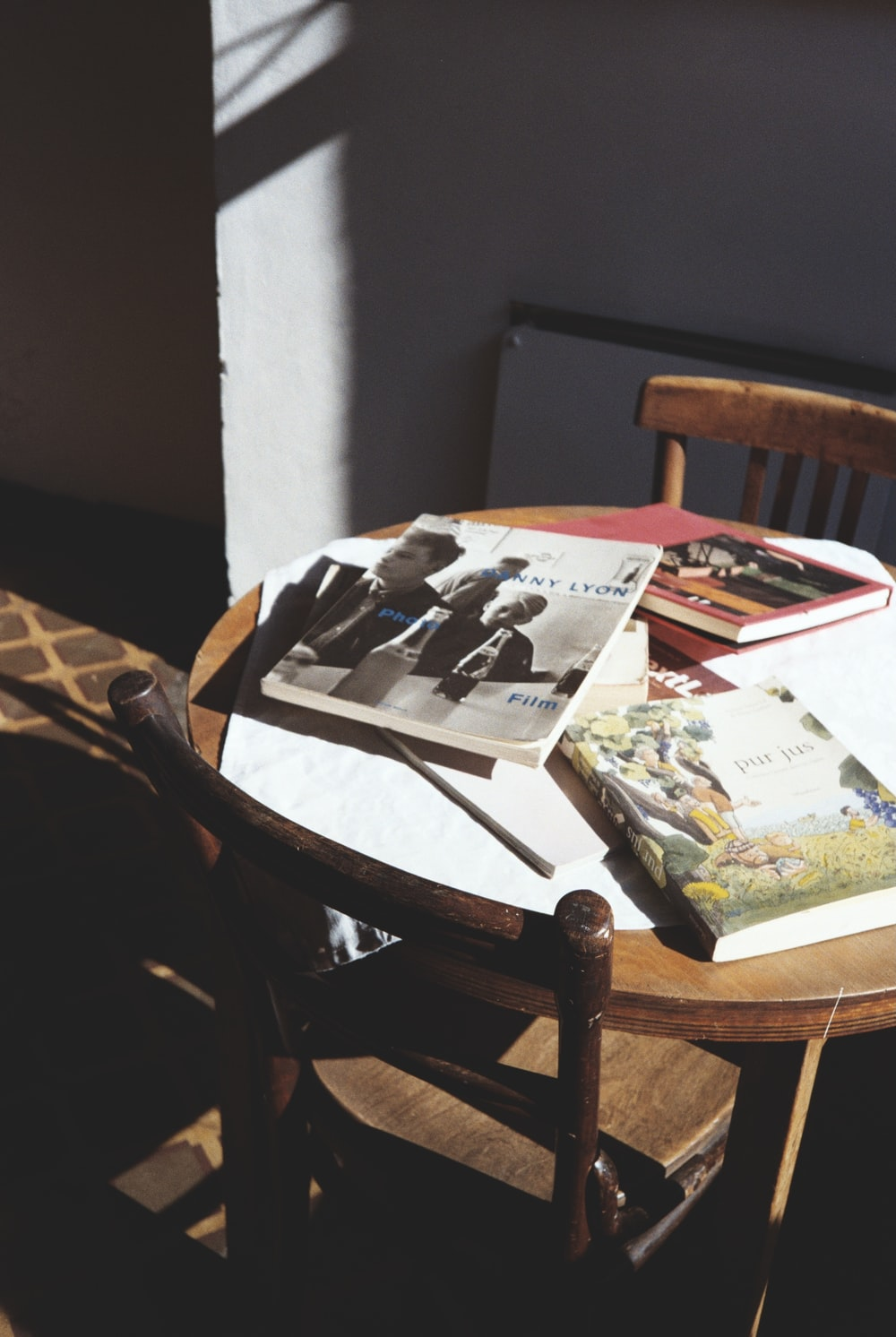 magazines on brown wooden table