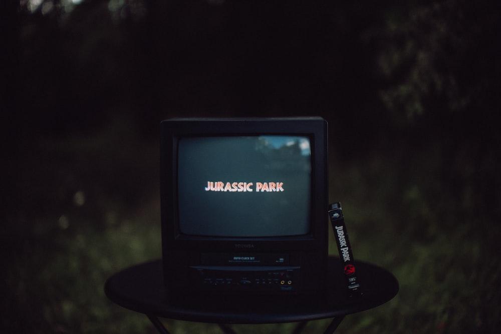 black crt tv on black table