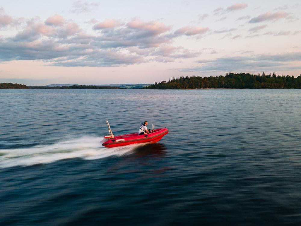 man in red kayak on sea during daytime