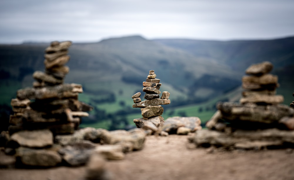 brown stone stack on brown rock