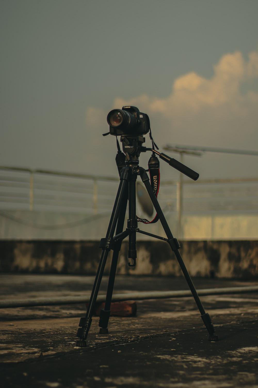 black and gray camera on tripod