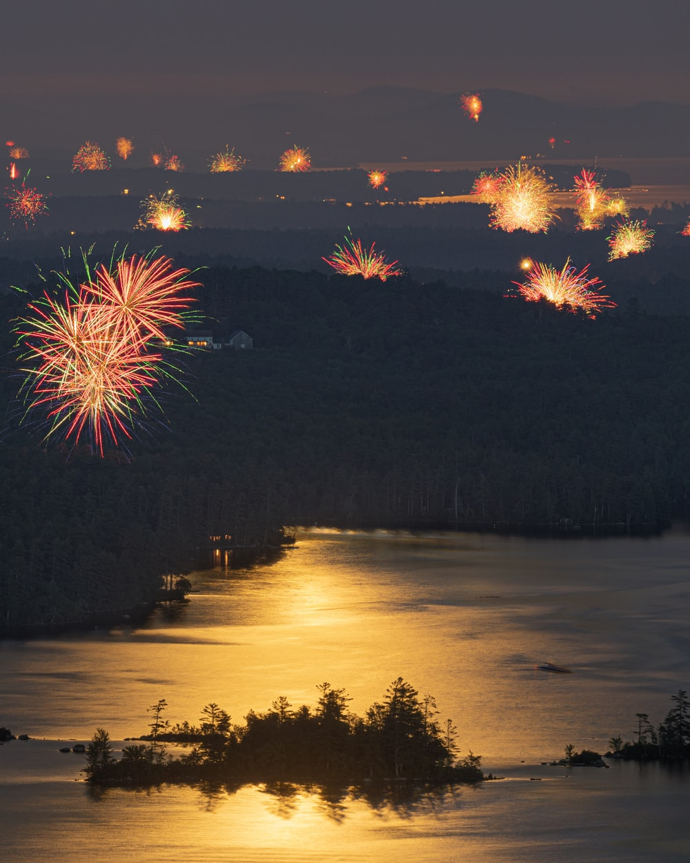 fireworks display over lake during night time