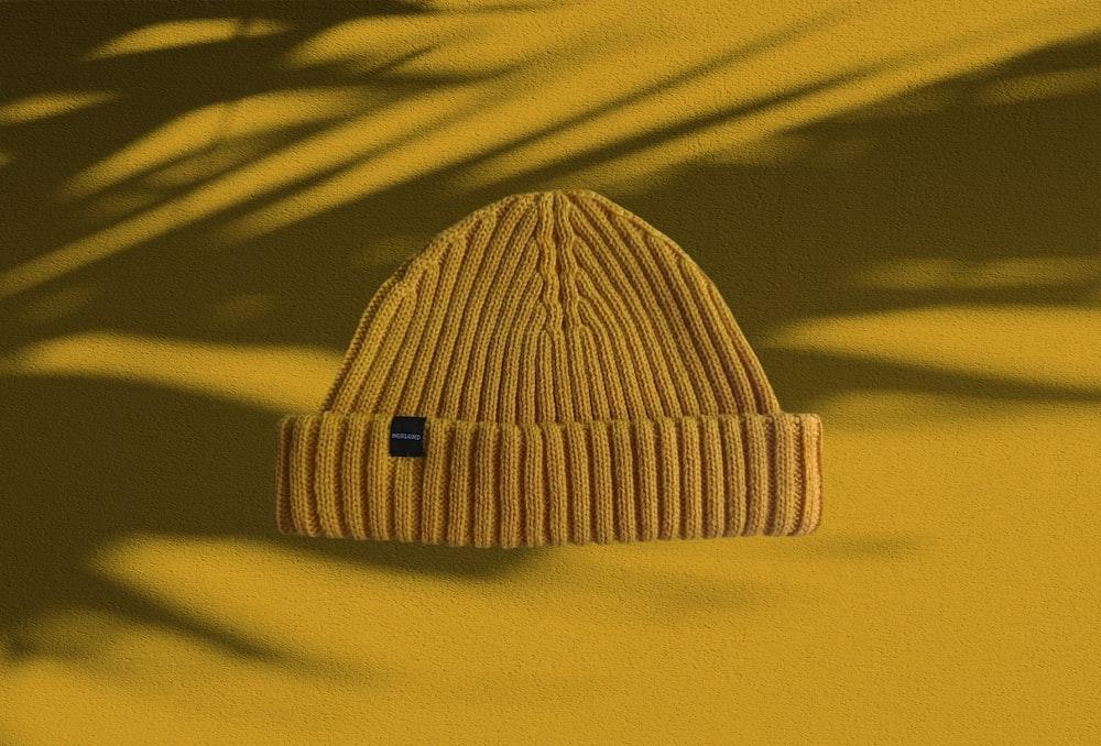 white knit cap on yellow textile