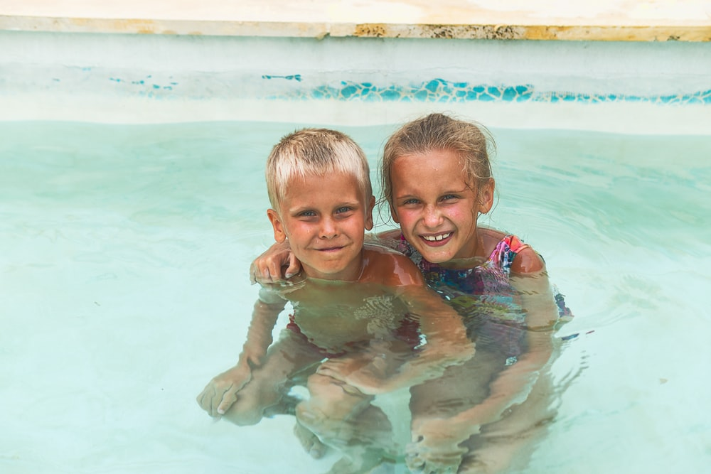 2 boys in swimming pool