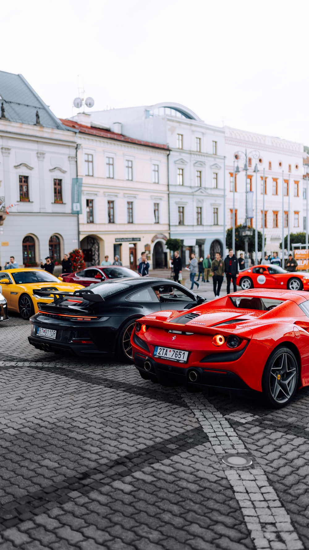 red ferrari sports car parked on street during daytime