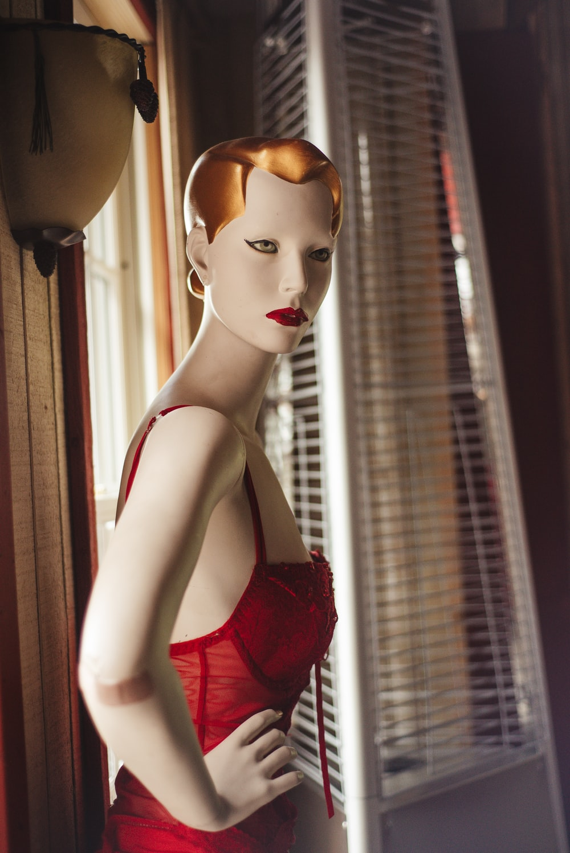 woman in red spaghetti strap top