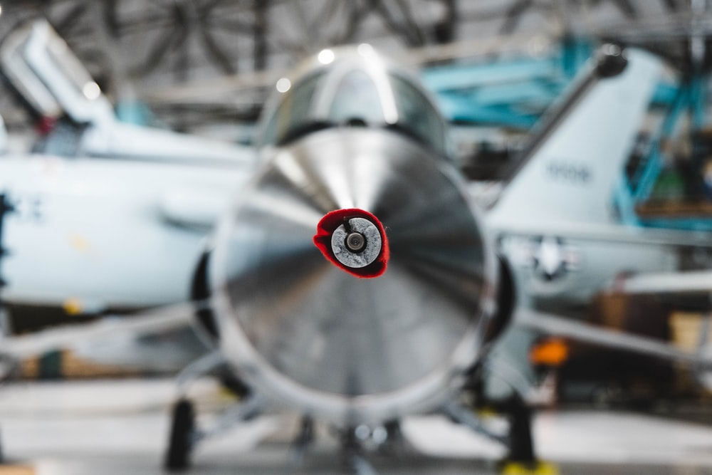 gray and red plane propeller