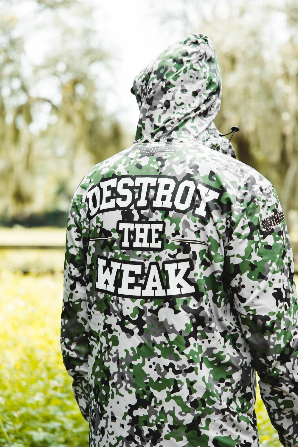 person in green and white camouflage hoodie