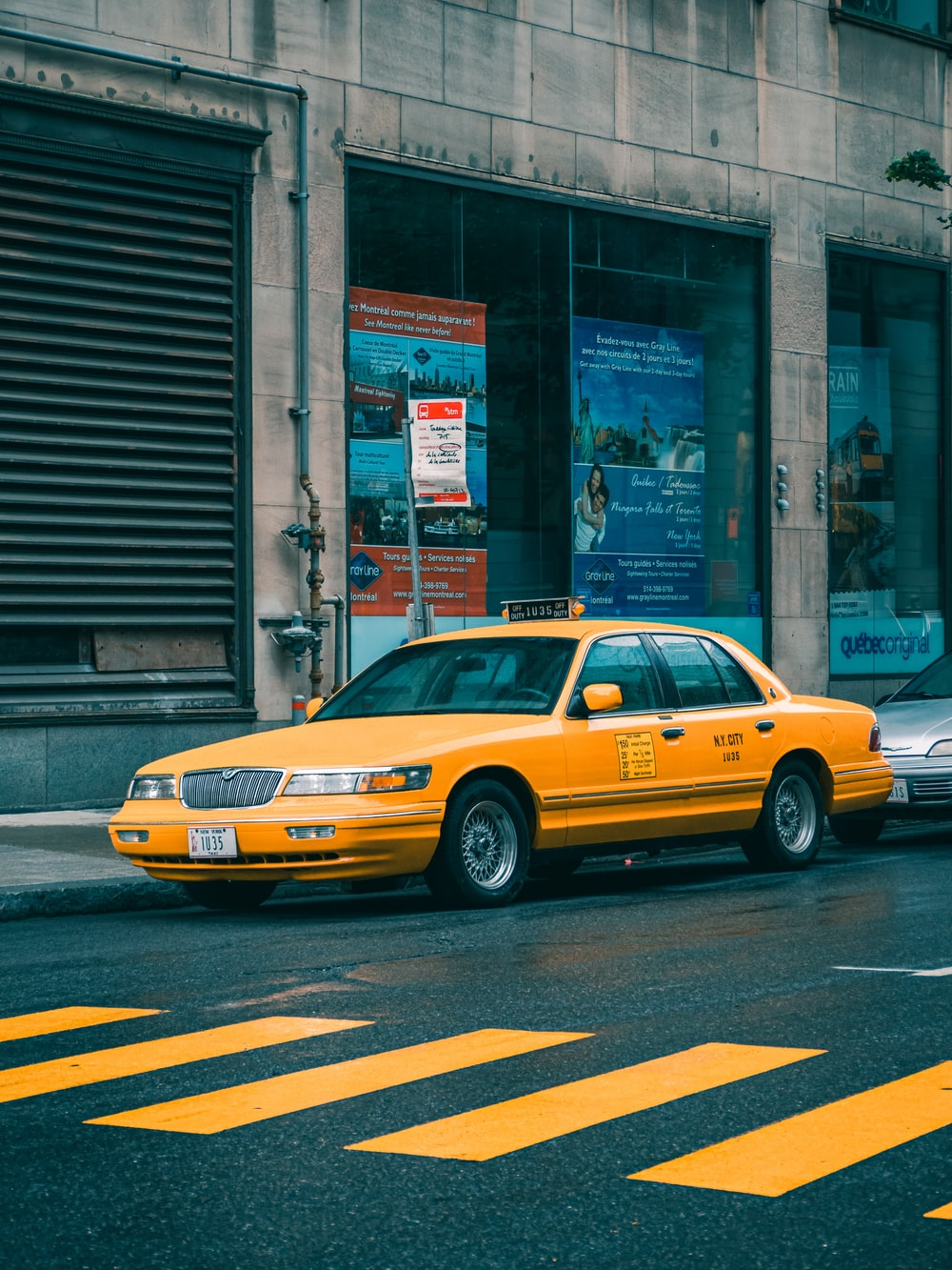 yellow taxi cab on street during daytime