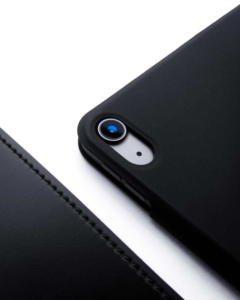 black iphone 7 on black leather case