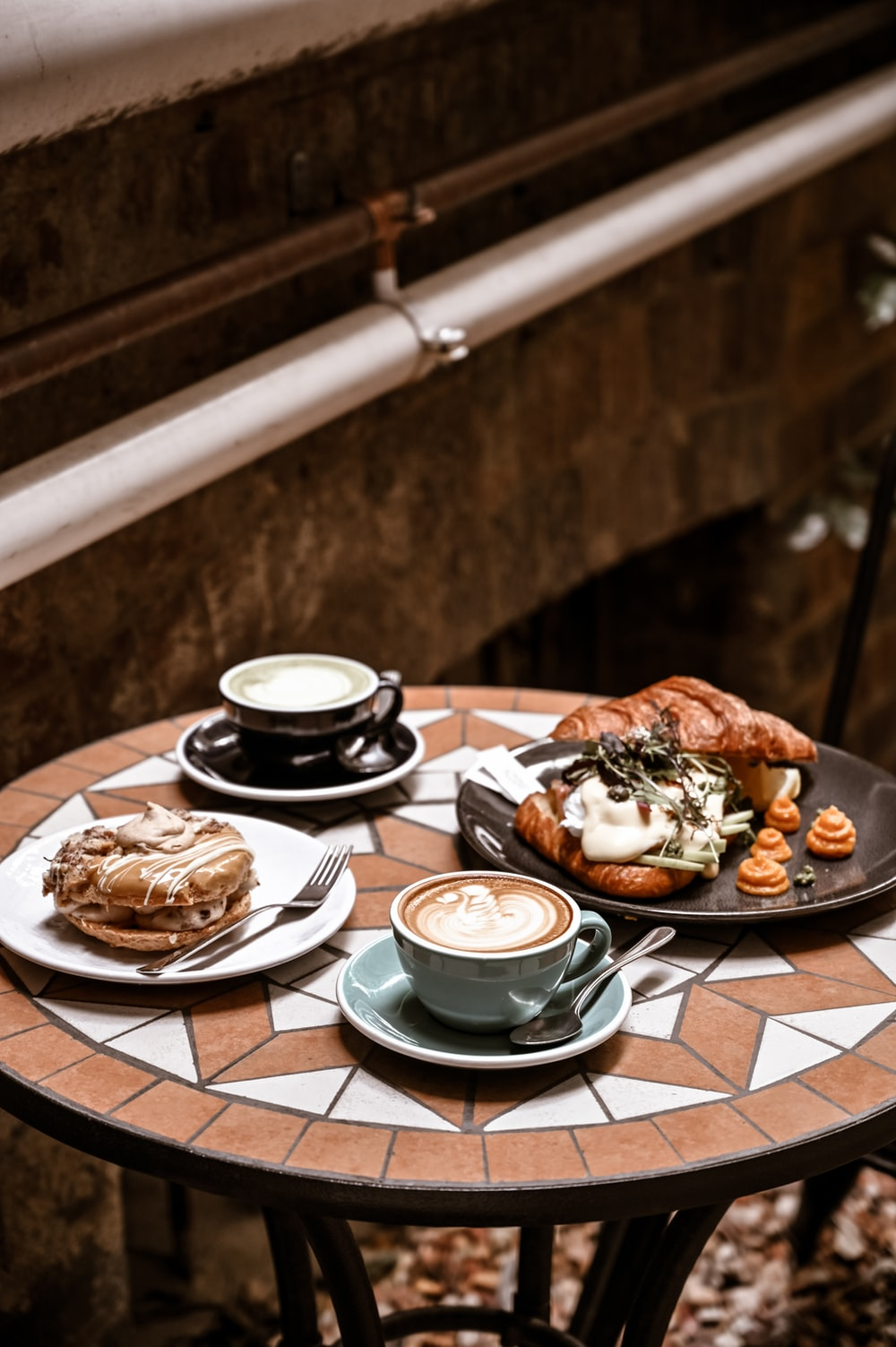 white ceramic plate with food on brown wooden table