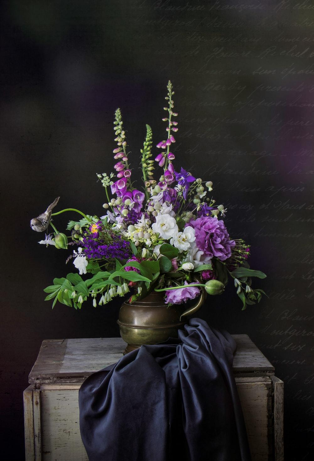 purple flowers in gray vase