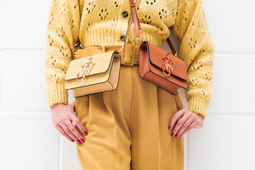 woman in brown leather sling bag