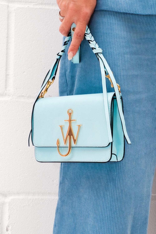 white and brown leather handbag