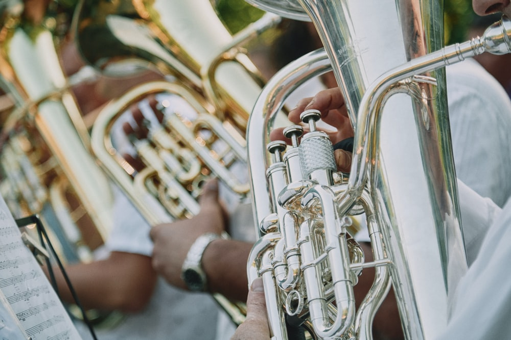 person playing trumpet during daytime