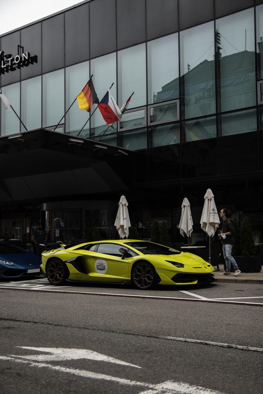 yellow ferrari 458 italia parked near white building