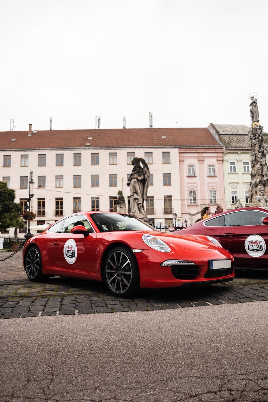 red ferrari 458 italia parked on street near building during daytime