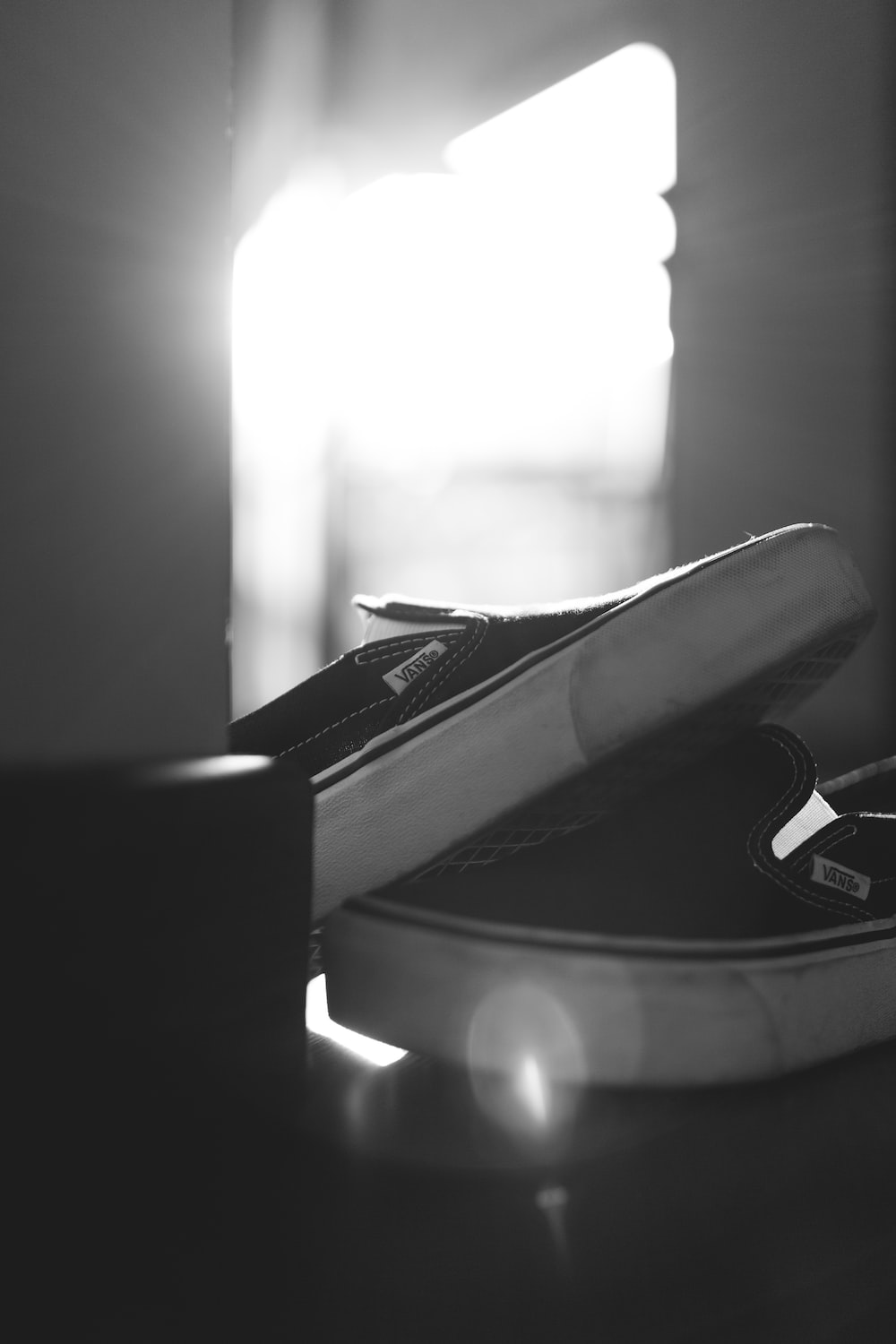 grayscale photo of book on table