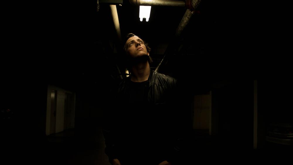 man in black jacket standing