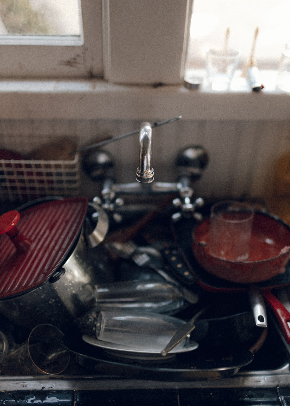 red and silver sink with faucet