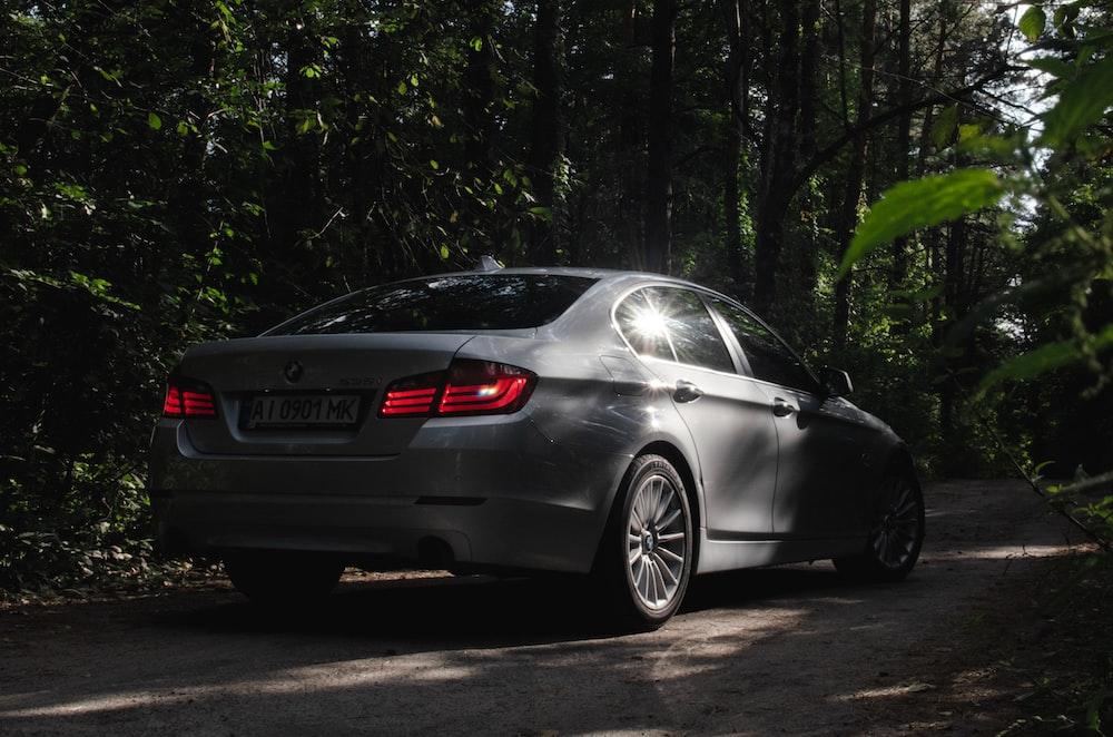 black bmw m 3 coupe parked on gray asphalt road during daytime