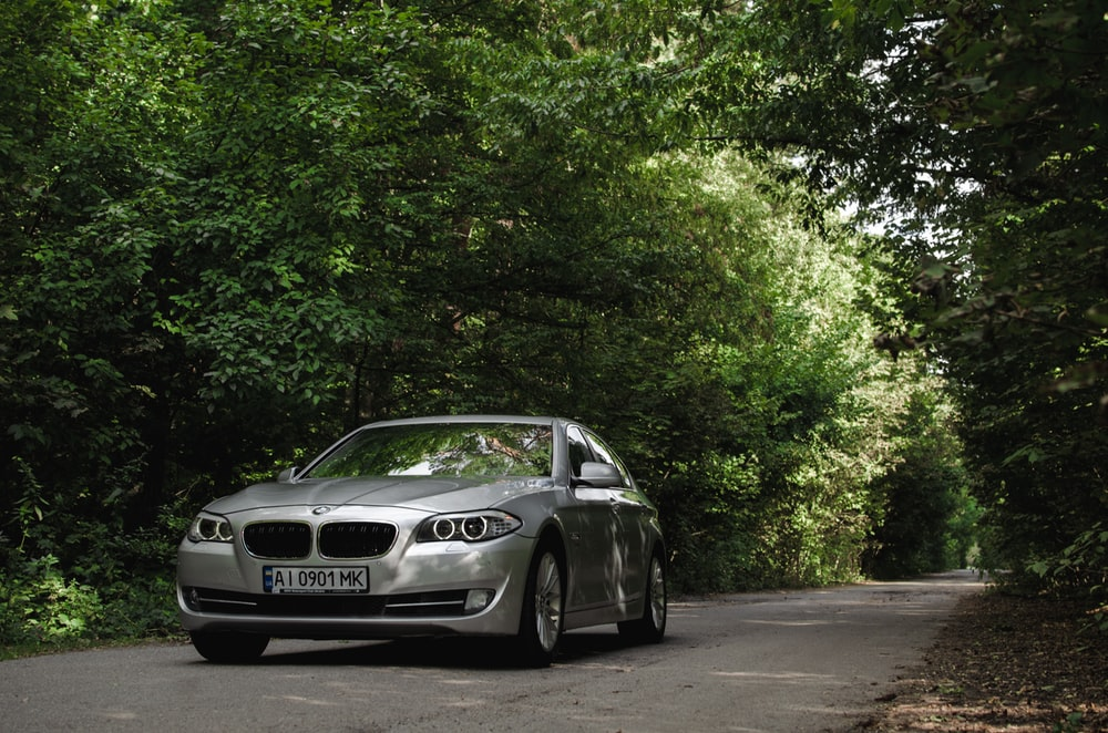 white bmw m 3 coupe parked on gray concrete road during daytime