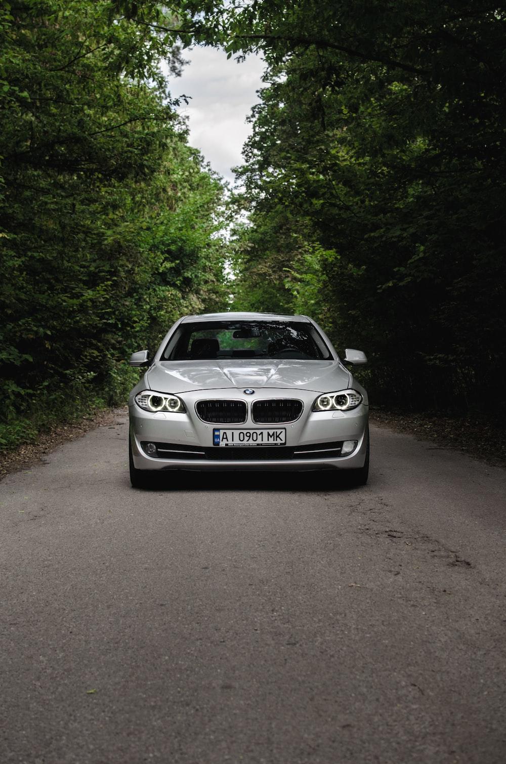silver bmw m 3 on road